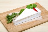 picture of brie cheese  - Soft brie cheese with rosemary thyme on the wood background - JPG