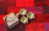 picture of ceremonial clothing  - Asian tea set served on a silk table cloth - JPG