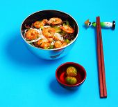 stock photo of rice noodles  - Vietnamese shrimp and rice noodles soup pho with a blue background - JPG