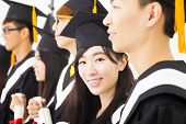 foto of graduation  - beautiful asian female college graduate at graduation with classmates - JPG