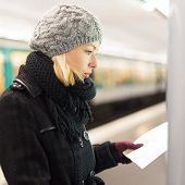 foto of orientation  - Casually dressed woman wearing winter coat - JPG