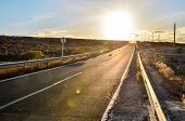 picture of canary  - Long Empty Desert Asphalt Road in the Canary Islands Spain - JPG