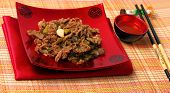 stock photo of stir fry  - Vietnamese beef stir fry served on a bamboo place mat - JPG