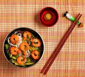 stock photo of rice noodles  - Vietnamese shrimp and rice noodles soup pho served on a bamboo place mat - JPG