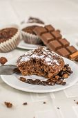 pic of chocolate muffin  - Cocoa and chocolate muffin with hazelnut on white table - JPG