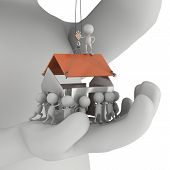 picture of real-estate-team  - Small people build house on the palm of big man - JPG