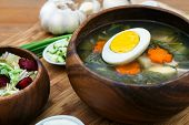 pic of sorrel  - Traditional Russian sorrel soup with egg in wooden bowl - JPG