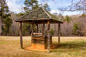 stock photo of wishing-well  - old historic water well in the forest - JPG