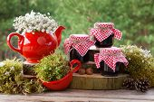 picture of teapot  - Red teapot tea cup and jars of healthy jam - JPG