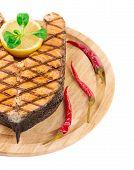 foto of salmon steak  - Grilled salmon steak on platter - JPG