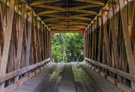 image of bridge  - The wooden trusses of the James Covered Bridge are seen from within - JPG