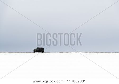 The Car In A Snowy Field
