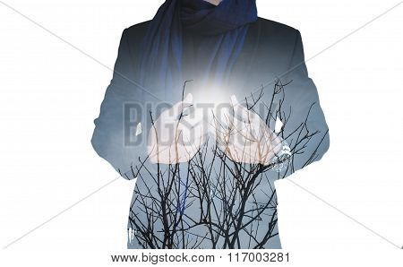 Double exposure, businessman with dry branches against sun, isolated on white background