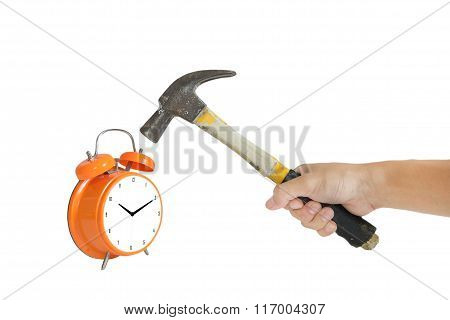 a man hand holding old hammer smashing alarm clock, isolated on white background