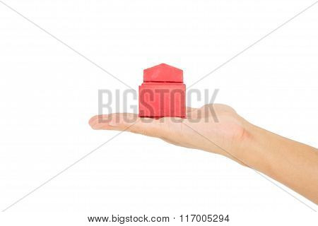 Opened red gift box on hand, isolated on white background