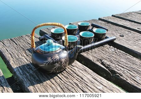 Tea-set on a wooden jetty