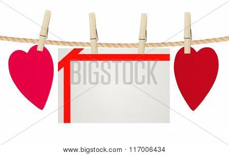paper hearts and card on rope isolated on white