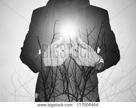 Double exposure, businessman with dry branches against sun, black and white