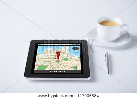tablet pc with gps navigator map and cup of coffee