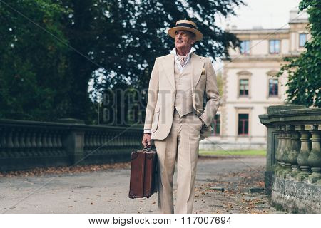 Vintage Commercial Traveler Leaving His Estate Walking Towards Camera.