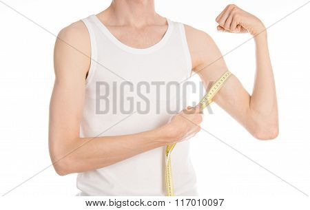 Bodybuilding And Sports Theme: A Thin Man In A White T-shirt And Jeans With Measuring Tape Isolated