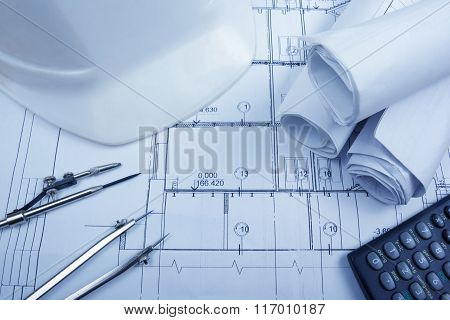Architectural blueprints, blueprint rolls, compass divider, calc