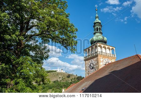 Church of Saint Wenceslas in Mikulov town with Holy Hill on background in Czech Republic
