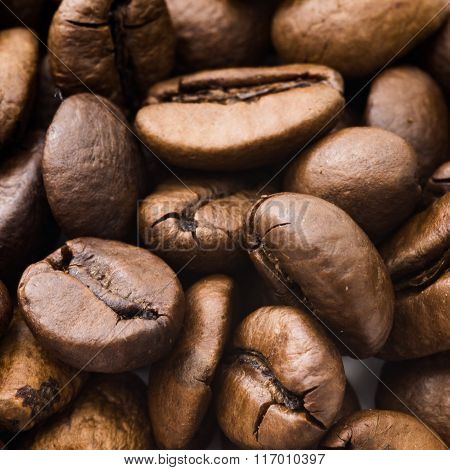 closeup of coffee beans on brown background