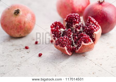 Cut and whole pomegranate fruit