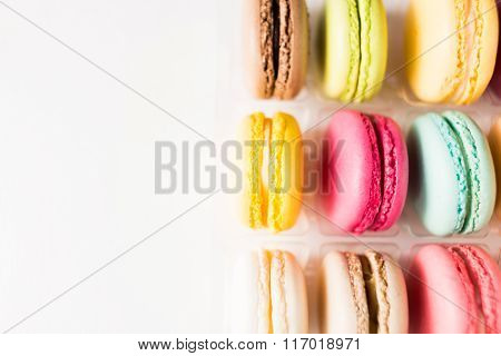 Box of french sweet delicacy macaroons isolated