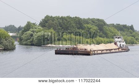 Barge Loaded With Yellow Sand Floats