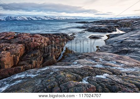 Coast Of The Arctic Ocean In The Winter On A Cloudy Day