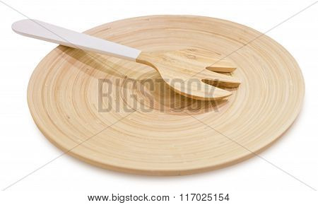 Wooden Fork Cutlery On A Wooden Plate