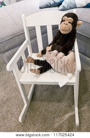 Monkey Doll And Mouse Doll On Rocking Chair