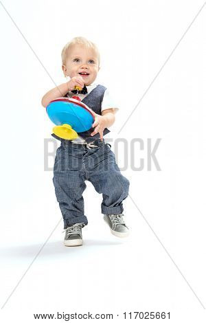 little child baby boy smiling playing with toy isolated on white background studio shot caucasian 1 year