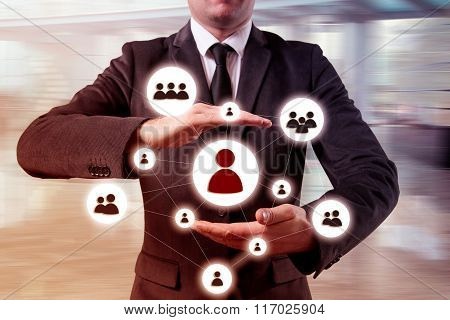 Hand carrying businessman icon network - HR,HRM,MLM, teamwork and leadership concept