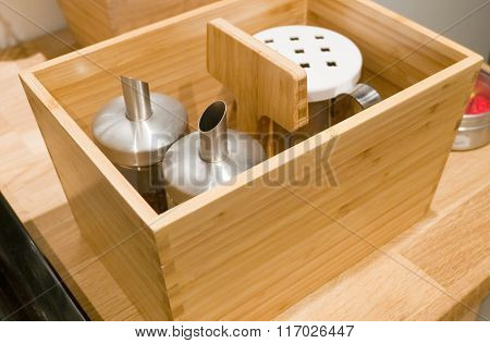 Glass Condiment Dispenser In A Wooden Box
