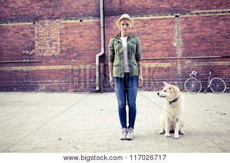 Hipster Woman With Dog And Vintage Road Bike In City