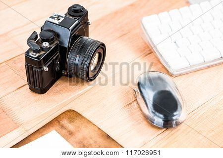 Close up view of an old camera on a desk