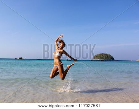 Lovely Young Woman Jumping On The Sunny  Kata Beach, Phuket, Thailand