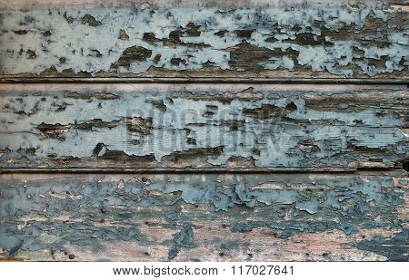 Old painted cracked blue wooden texture. Vintage rustic style. Natural surface, background and wallp
