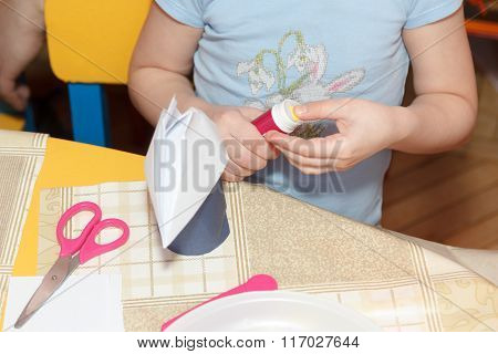 Small Child Hands Glue Paper Crafts At School Desk