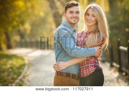 Two lovers in the autumn park