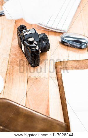 View of retro camera on wooden desk