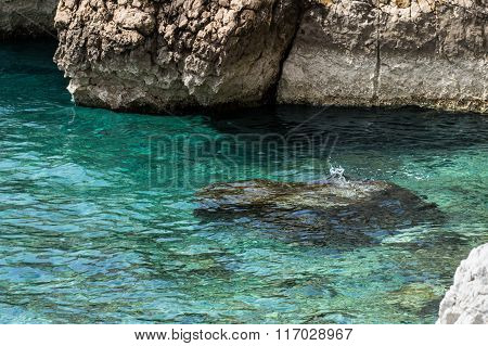 Turquoise sea, clean clear water and rocks