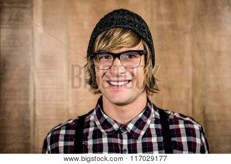 Happy blond hipster smiling at camera