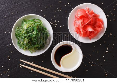 Wakame Seaweed Salad With Sesame Seeds On A Table. Horizontal Top View