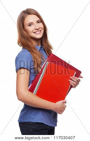 Young woman holding textbooks