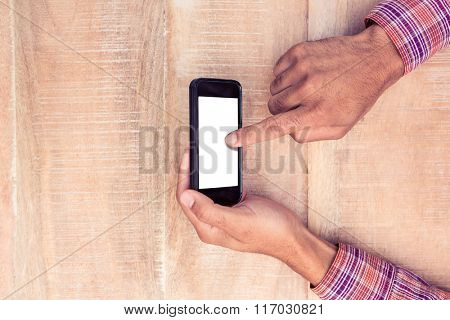 Directly above shot of man texting on smart phone