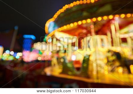 Defocused shot of carousel near Ferris Wheel in Hong Kong at night
